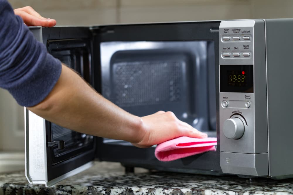 How do I clean my microwave after my kids have made a mess