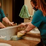 Cleaning the bathroom in personal protective equipment