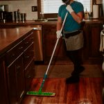 house cleaner mopping with PPE