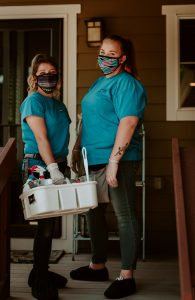 house cleaners in masks and gloves